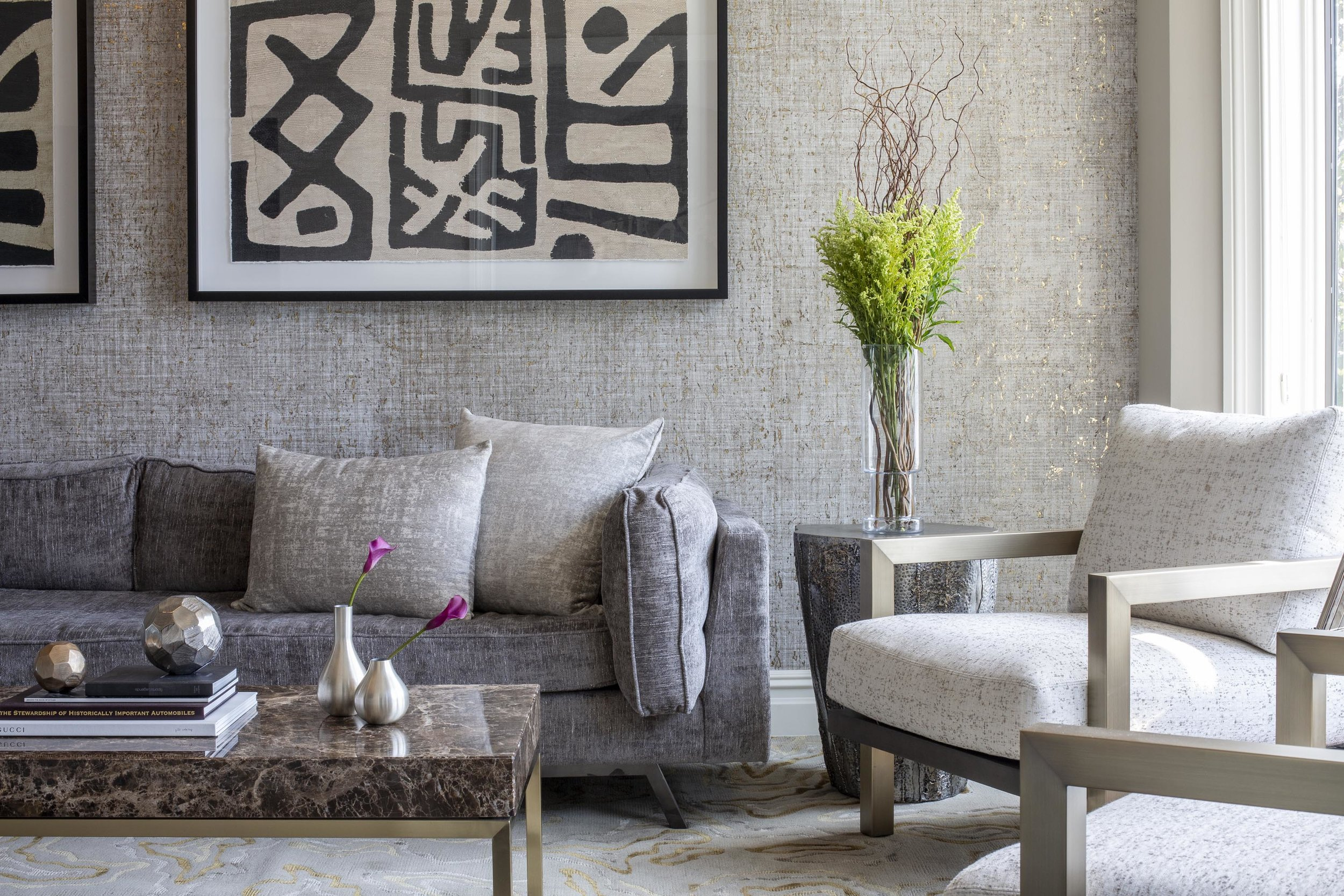Living room with sofa, armchairs, center table, indoor plant modern wallpaper and artwork on the wall
