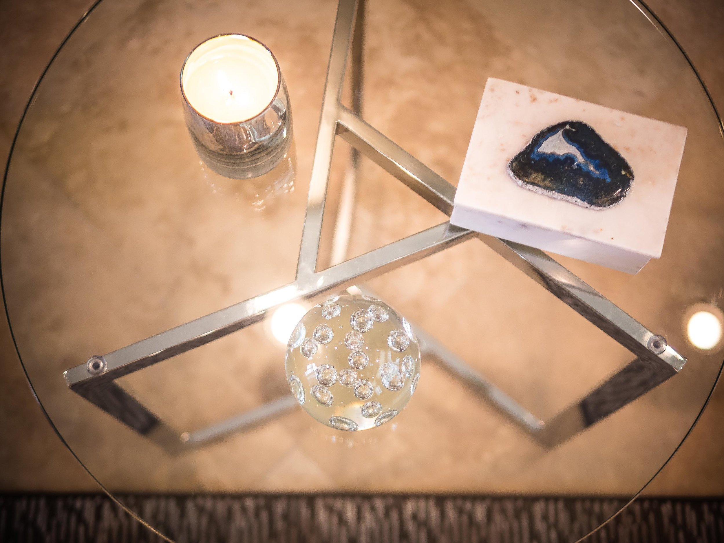 Round glass table detail with custom accessories