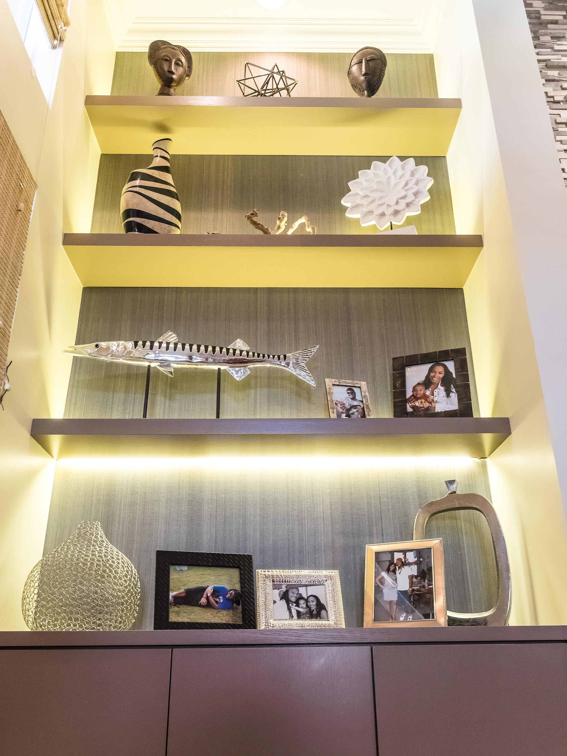 Built-in cabinetry with family picture frames and custom accessories