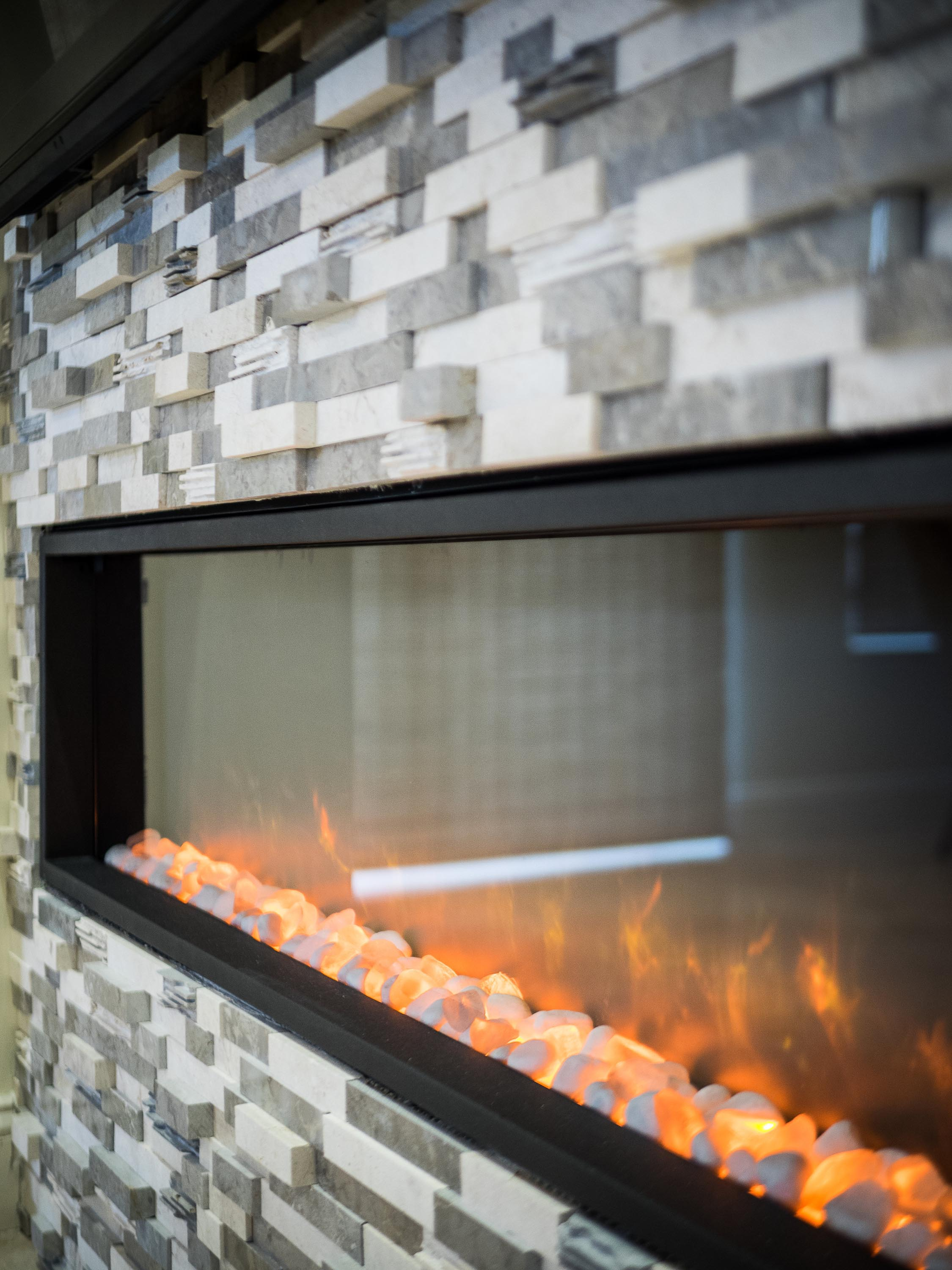 A brick fireplace with burning fire detail