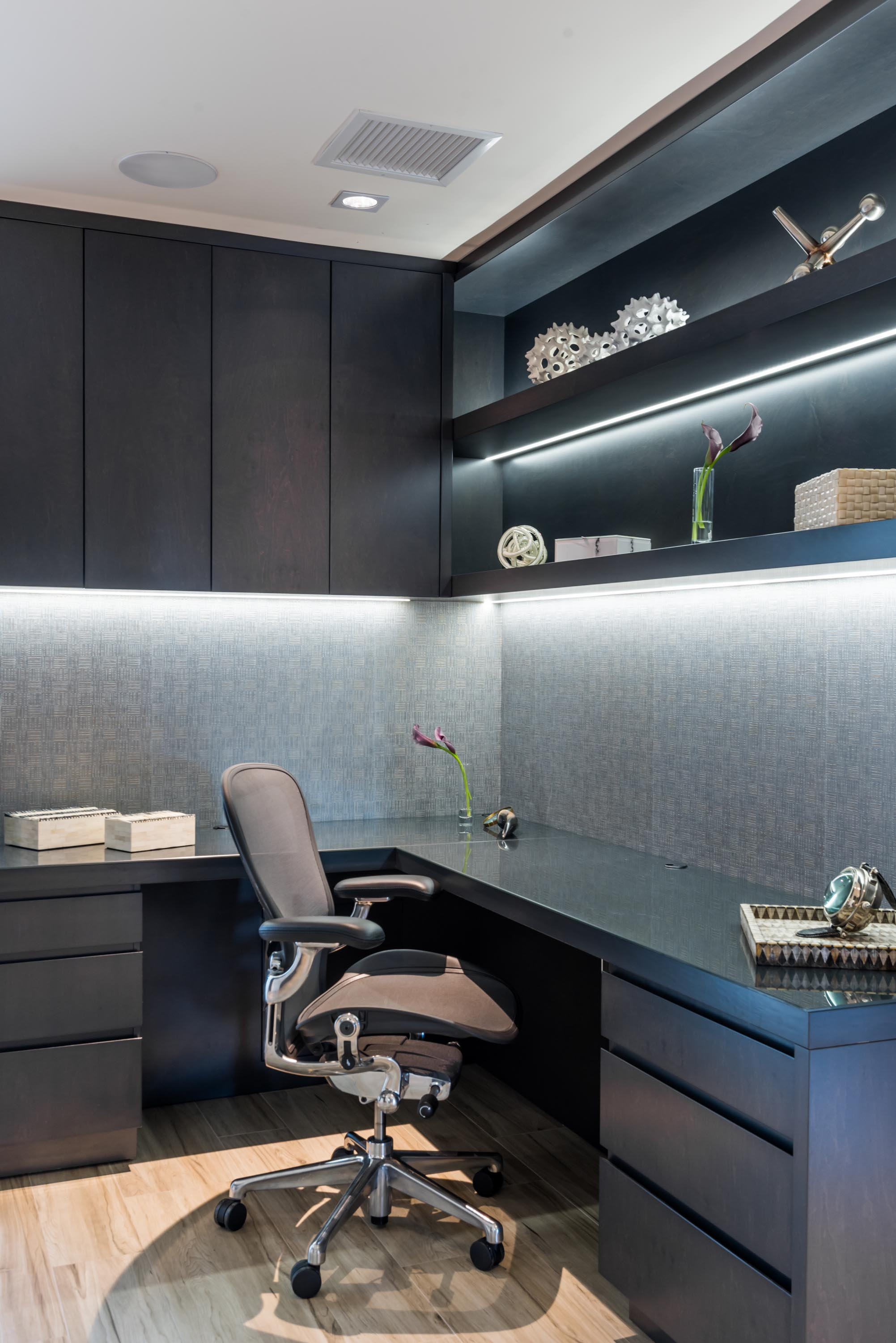Home office with office chair and refined custom cabinetry