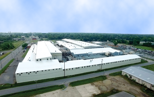 About - We operate one of the largest post-consumer and post-industrial waste separation facilities in North America. Mixed paper and plastic destined for landfill are transformed into a new raw material, and manufactured into high performance building materials for exterior walls and commercial roofs.