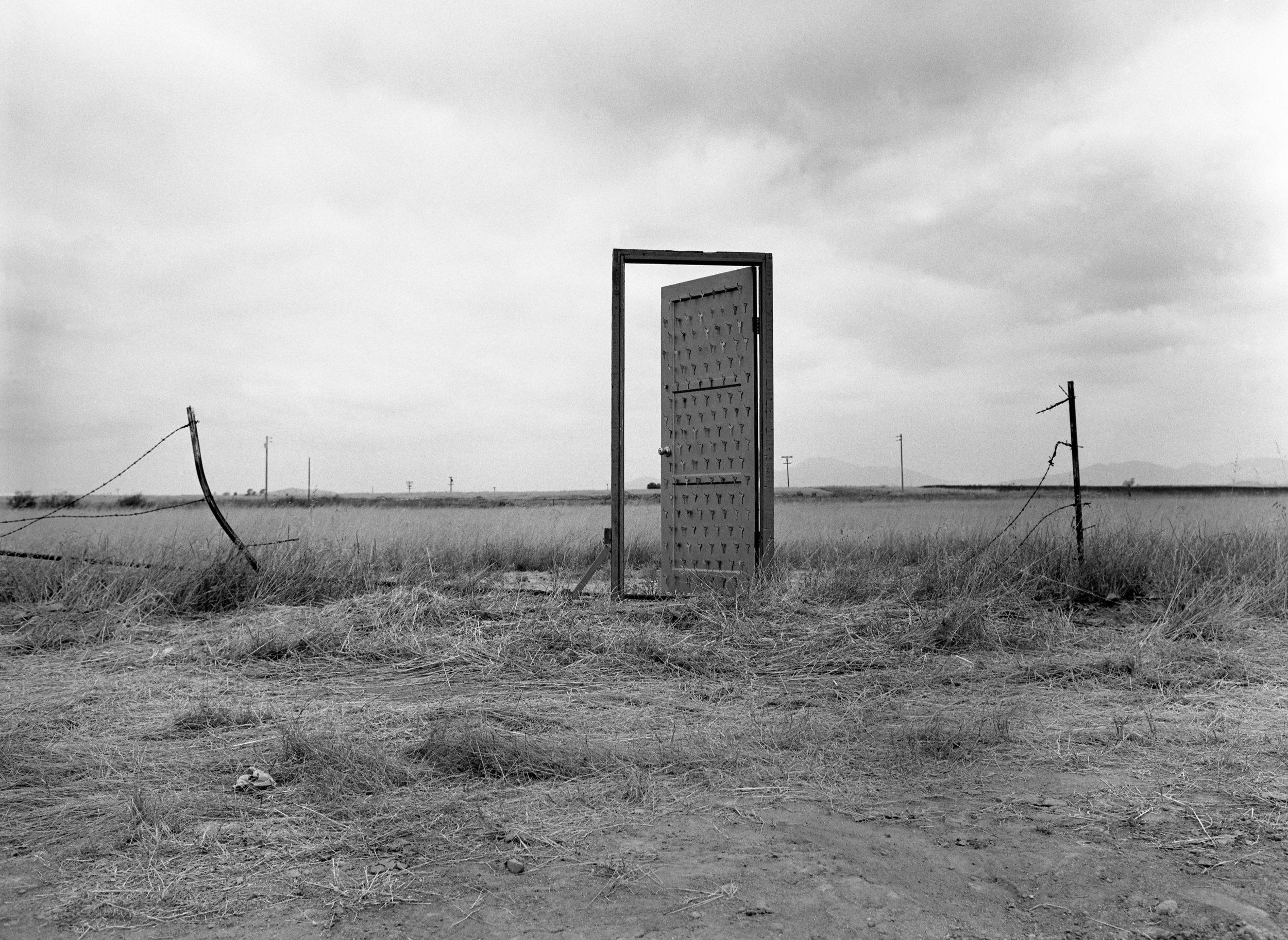 Richard Lou,  Border Door , 1988; Performance; Documentary photograph by James Elliot