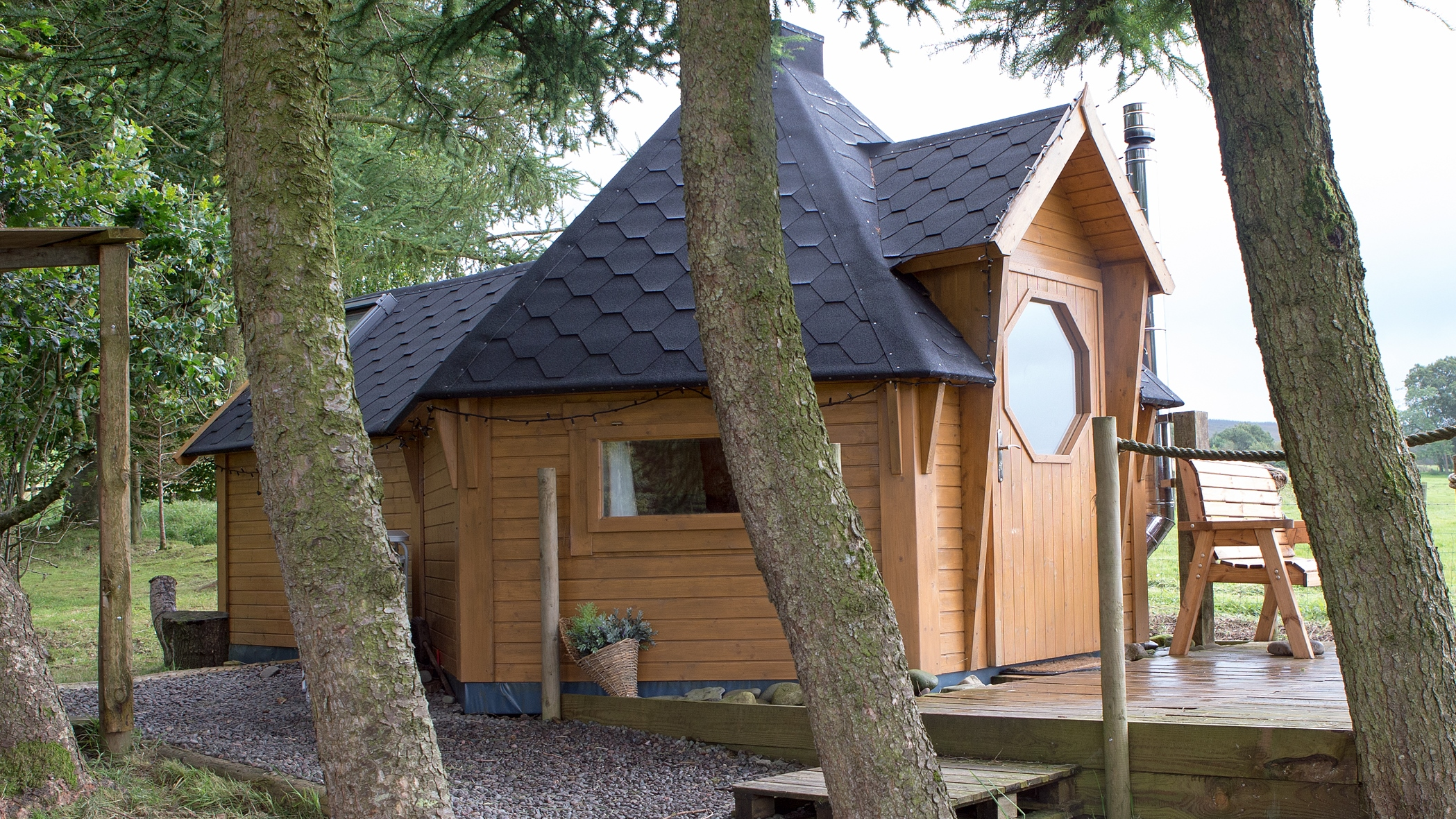 Glamping Cabin behind trees.jpg