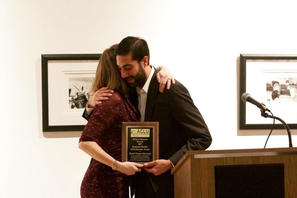 Shahid Haque, being awarded the  ACLU's Jeannette Rankin Civil Liberties Award , in  acknowledgement of his service  to immigrants in the State of Montana.