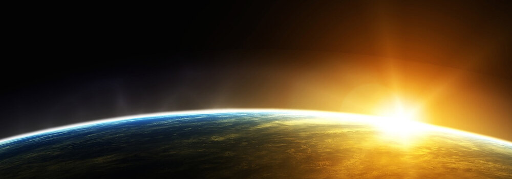 IT-Sunrise-Over-Earth-on-Right-Horizontal.jpg