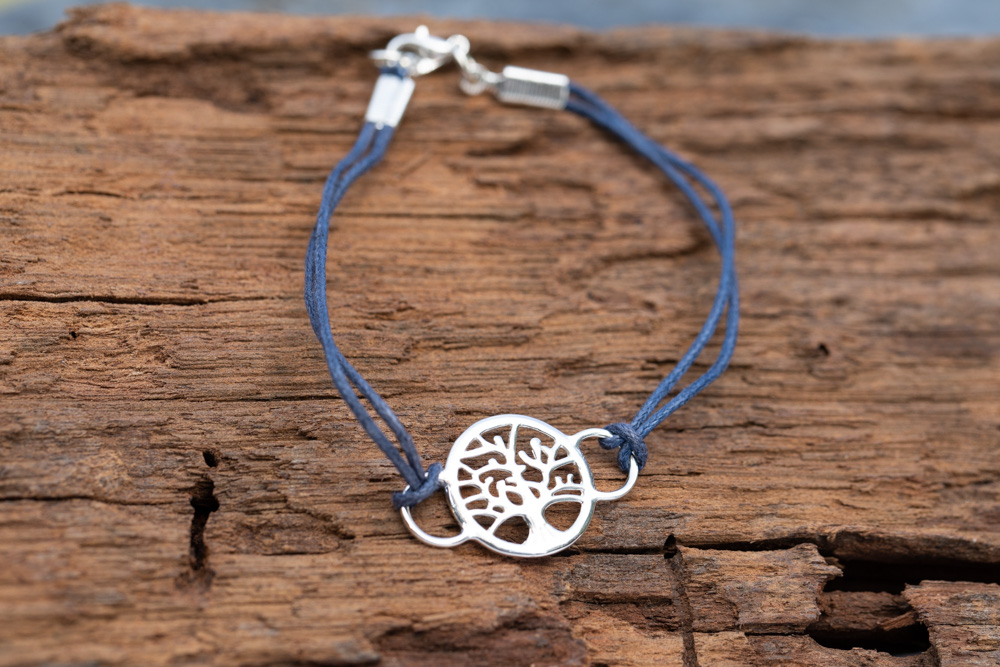 Sterling silver tree of life bracelet in blue cord - £20