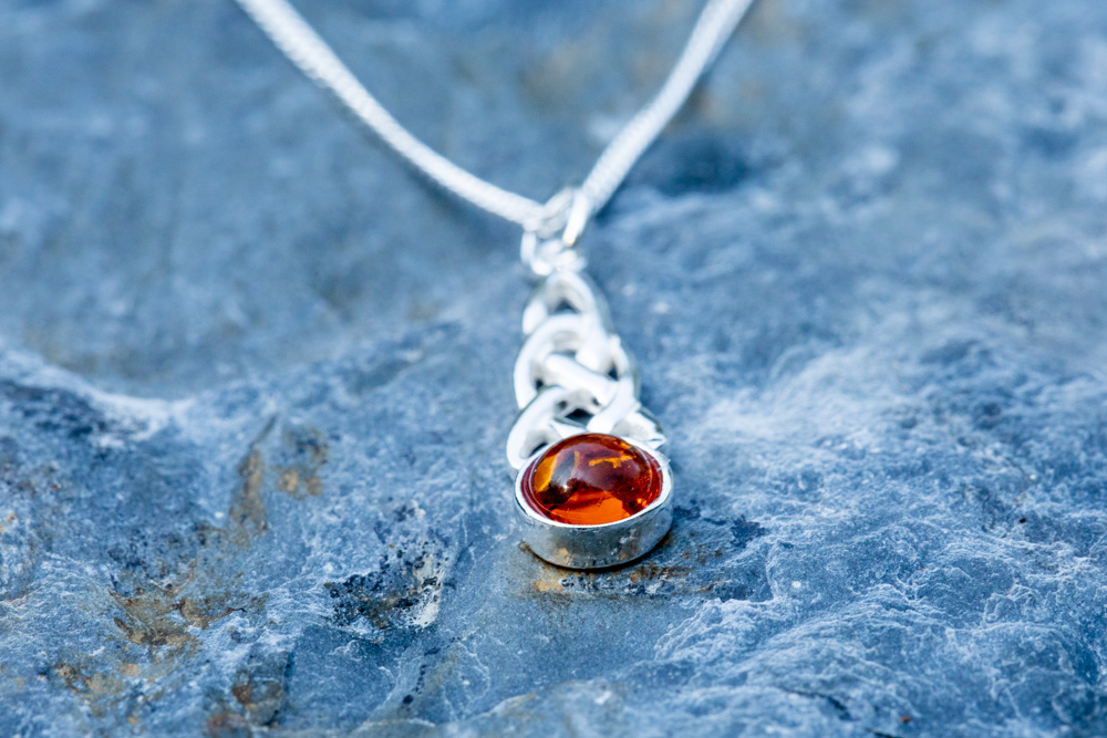 """Sterling silver Celtic pendant incorporating Baltic amber on 18"""" sterling silver chain - £40"""