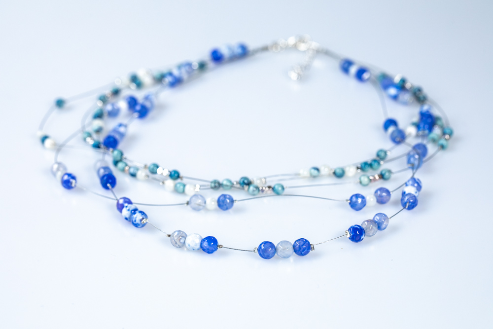 Cascade 5 strand beaded illusion necklace in ocean blues - £30