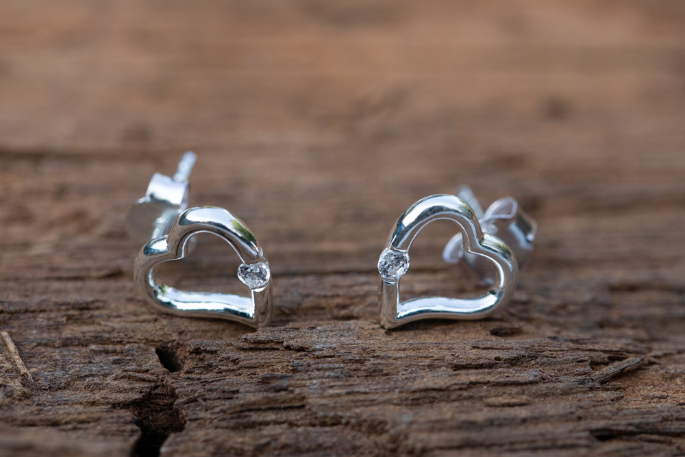 Sterling silver heart shaped studs with cubic zirconia - £24