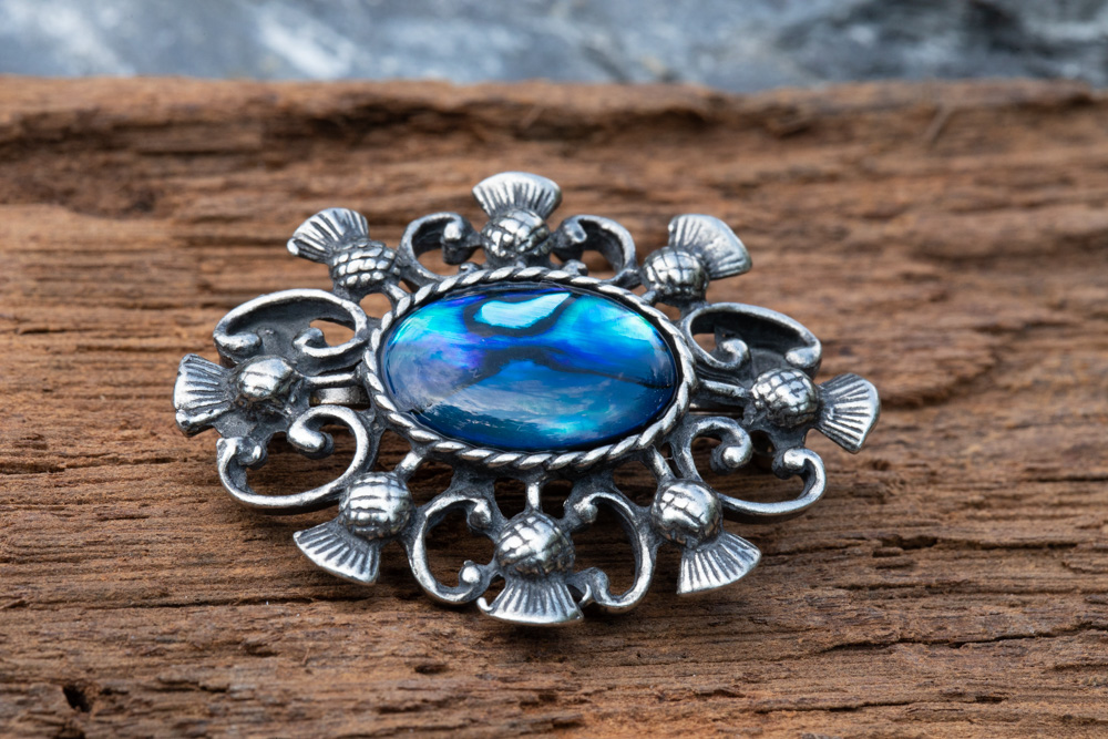 Thistle brooch in pewter incorporating blue abalone paua shell - £18