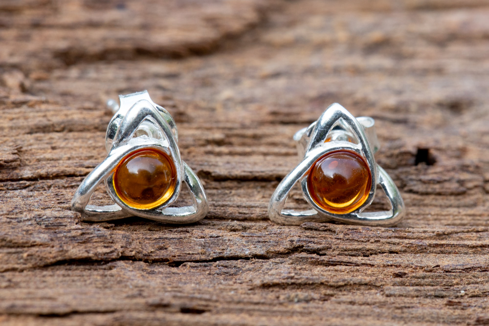 Sterling silver Celtic stud earrings incorporating Baltic amber - £34