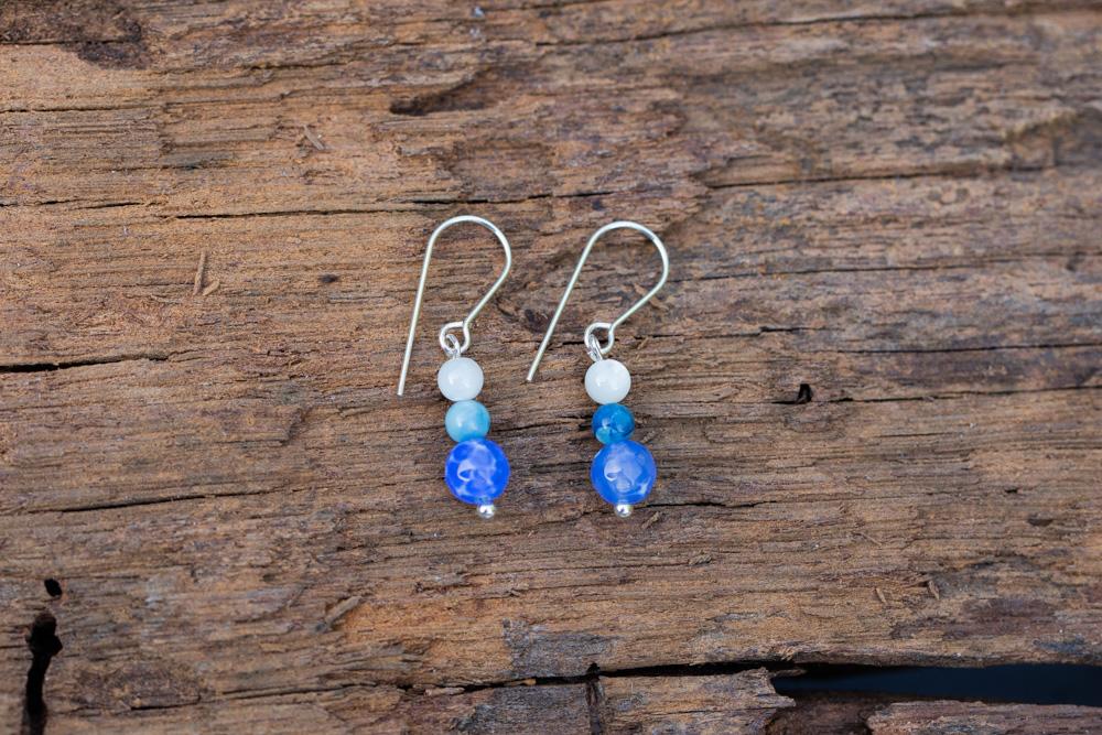 Beaded earrings on sterling silver hooks in ocean blues - £15