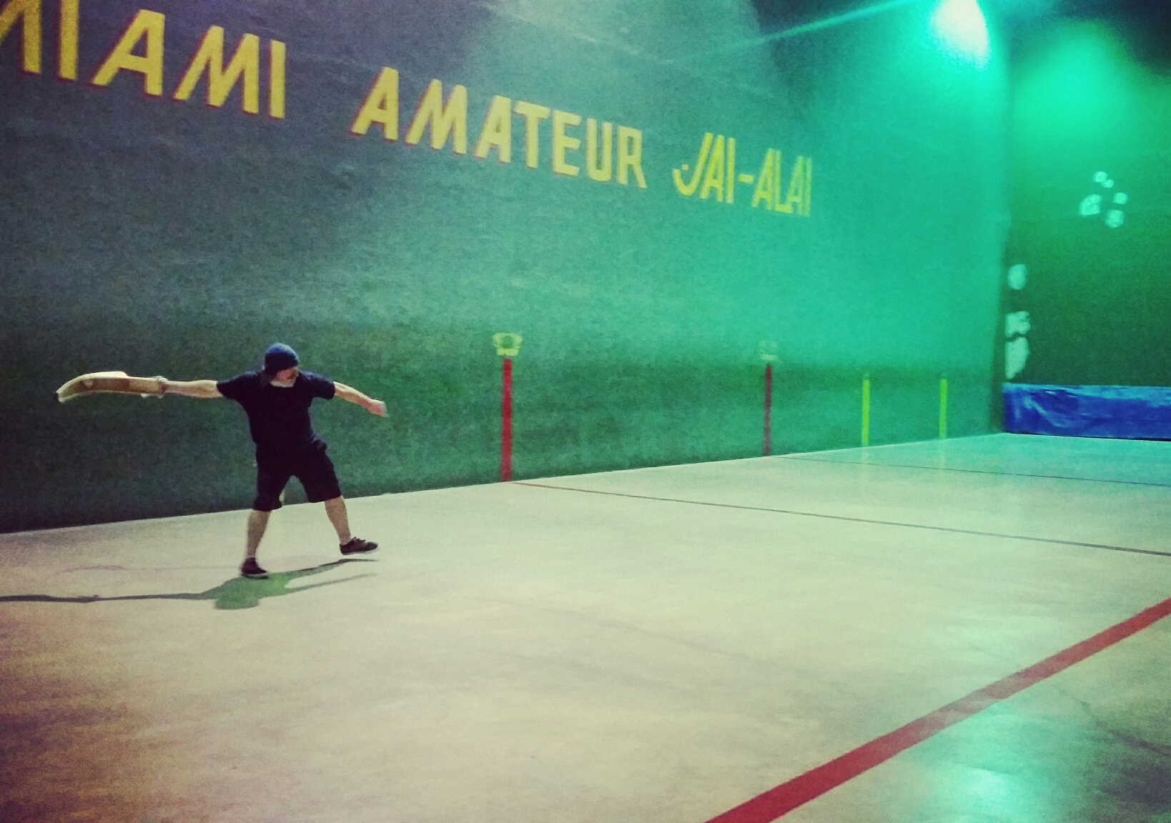 The author attempting, and subsequently failing, to huck the pelota with his cesta across the cancha.