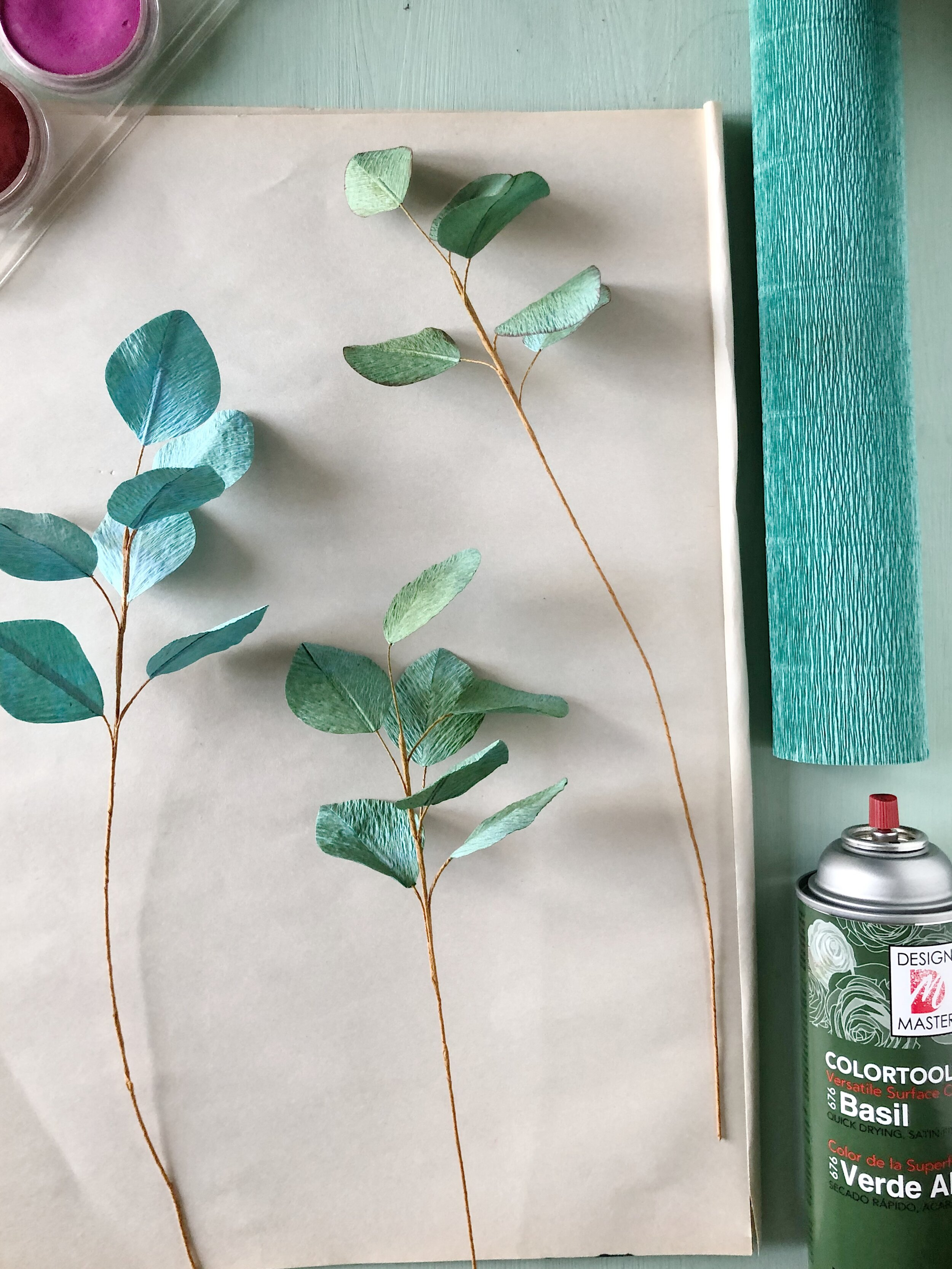 ONE - I first put together my eucalyptus leaves and then arranged them together to create a short branch. I used 180 g Italian crepe paper in Tiffany Green (#17E/A) for the leaves and Twig (#567) for the stems/branch.