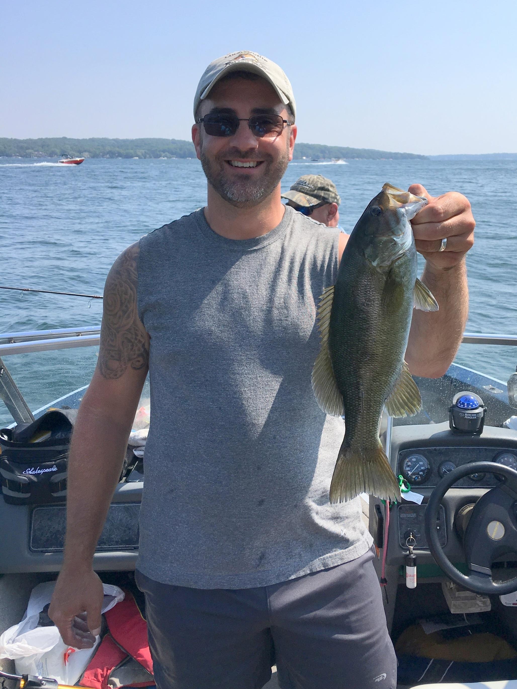 Member Jason Cashmore with a Lake Geneva smallmouth bass.
