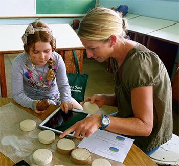 6th–grader Rosemary Bearden and Mandy Lemes making clay 'ulu