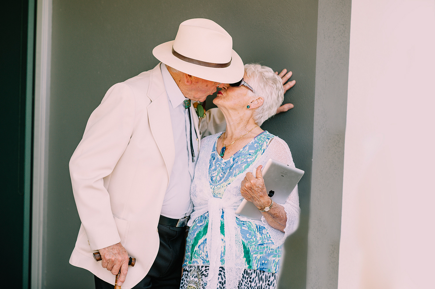 Old man and wife kissing