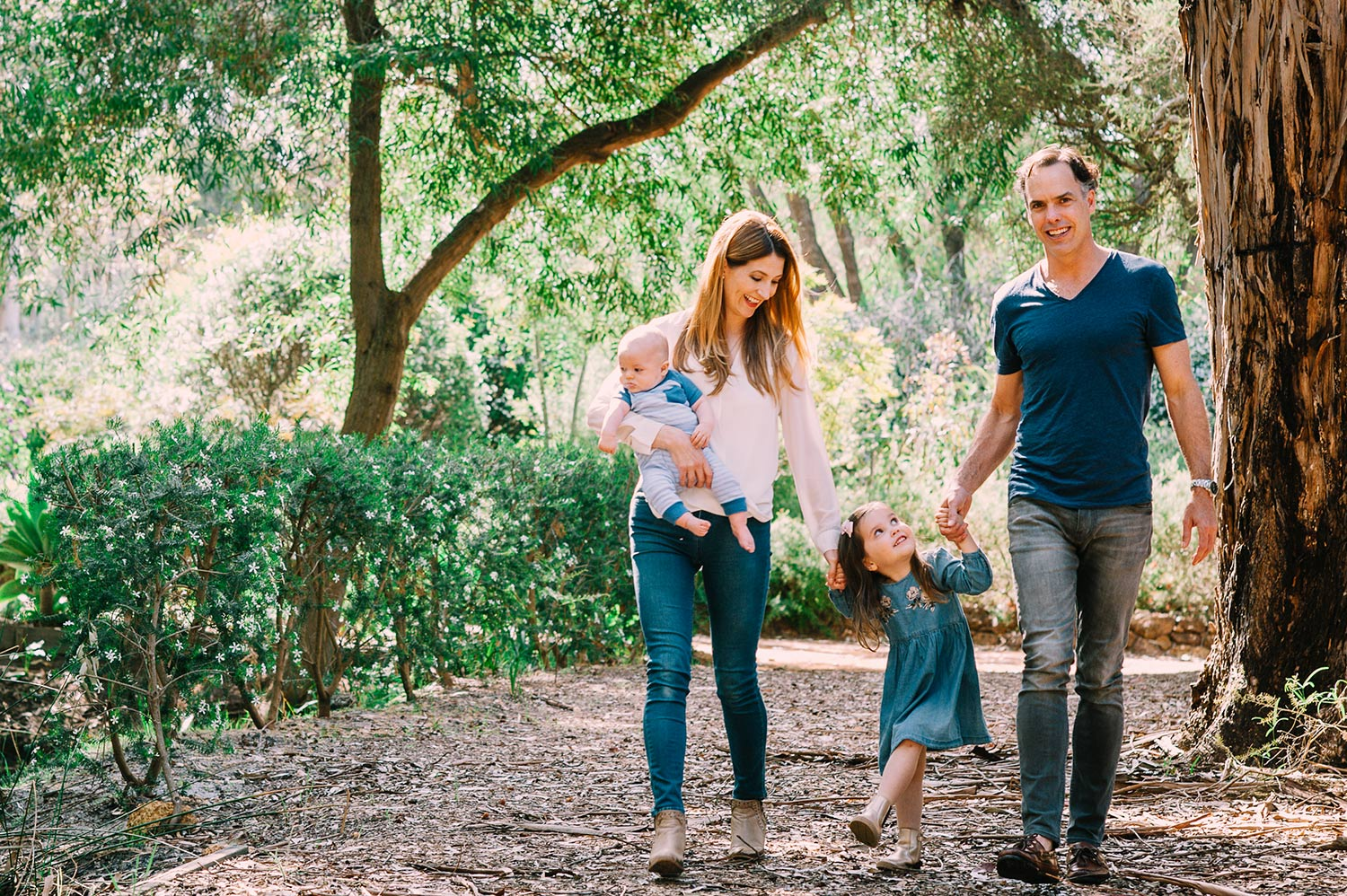 Mum, dad and kids in forest - photographer in perth