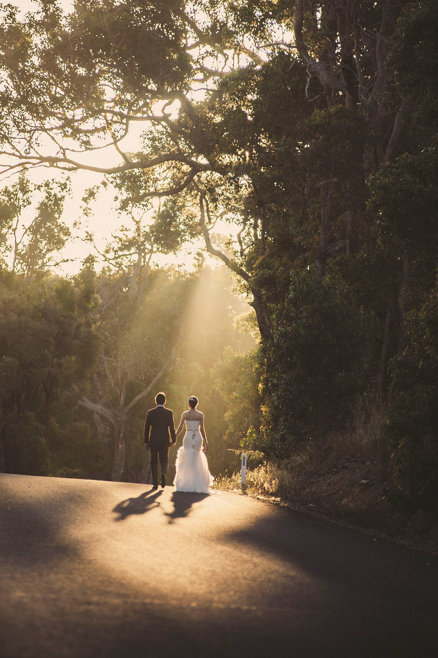 Bride and groom in the sunlight at Chandeliers On Abbey - Leigh and Janelle.jpg