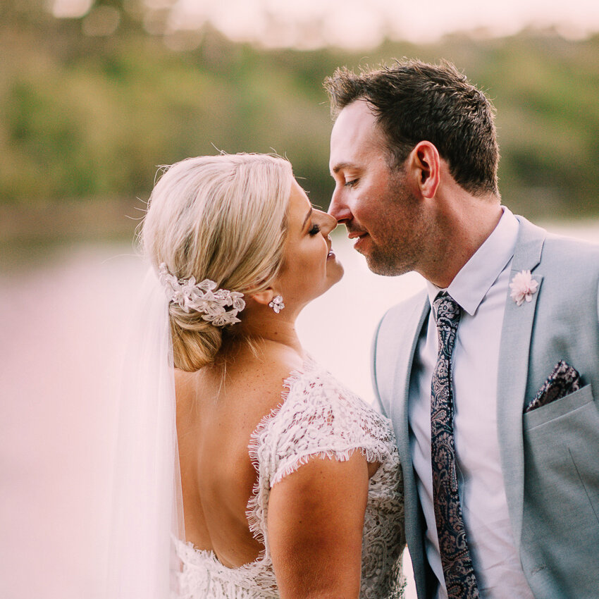 BRIDE AND GROOM KISSING AT EIGHT WILLOWS RETREAT MARGARET RIVER.jpg