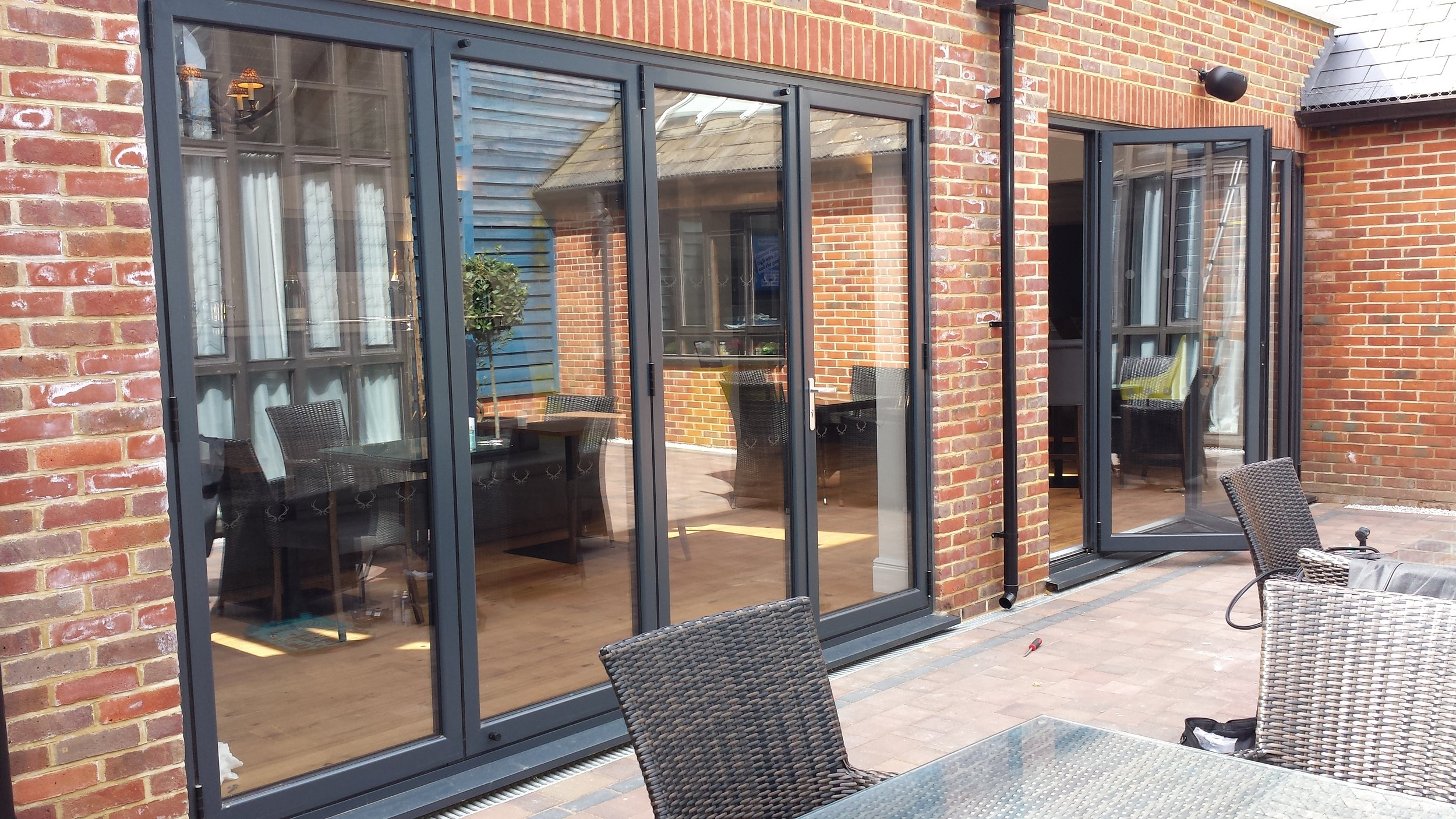 Bi-Fold Doors - At Oakwood Windows we are proud to supply and install high-specification, bespoke ALUK bi-fold doors. Our bi-fold range helps you to seamlessly blend the outside and inside space of your home, enabling true open-plan living.The combination of striking design and high functionality ensure that our doors incorporate the highest specifications of security, efficiency and finish.