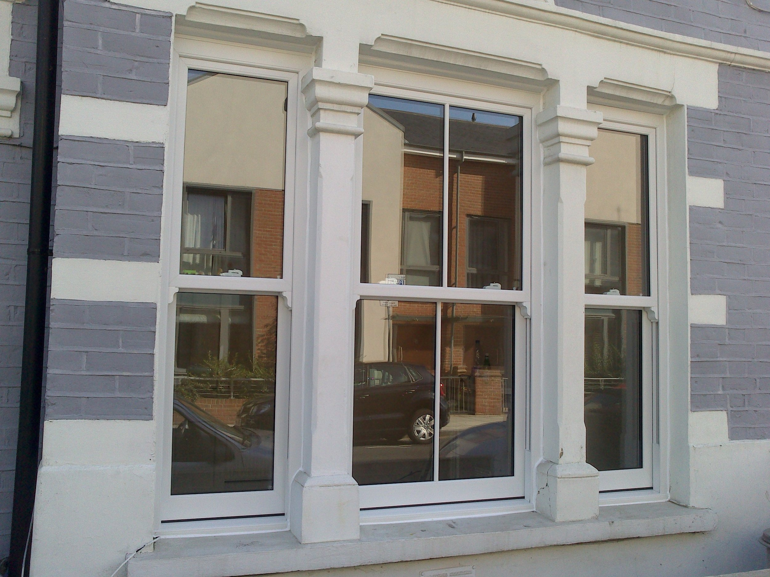Sash Vertical Sliding Windows - Traditional timber sash windows have great character and blend perfectly with period buildings, yet they pose many functionality issues in terms of security, energy efficiency and maintenance.Our bespoke, UPVC sash windows provide the perfect solution to this problem by combining traditional design with modern window technology.For more information please follow the link below or call our showroom team who will be more than happy to discuss your enquiry: 020 8361 0128.