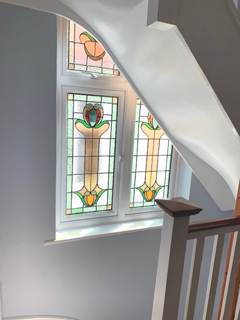Encapsulation - Stained glass windows add touches of vintage class to your home by acting as beautiful features in hallways and stairwells. Unfortunately, changing technology has seen these units become outdated in terms of energy efficiency and security.Rather than dispose of ornate features that are part of the history of your home, we can provide a solution that incorporates your stained glass into bespoke double glazed units. This new triple glazed unit is highly energy efficient and secure, whilst retaining the charm of the original artwork.After painstakingly removing the stained glass it will be hand restored to its original splendour before being carefully sealed into our high-spec double glazed units. We will provide a temporary replacement pane to ensure your home is kept warm and secure during the transition process.If you would like to book a no obligation home survey please call our showroom team who will be more than happy to discuss your enquiry: 020 8361 0128.