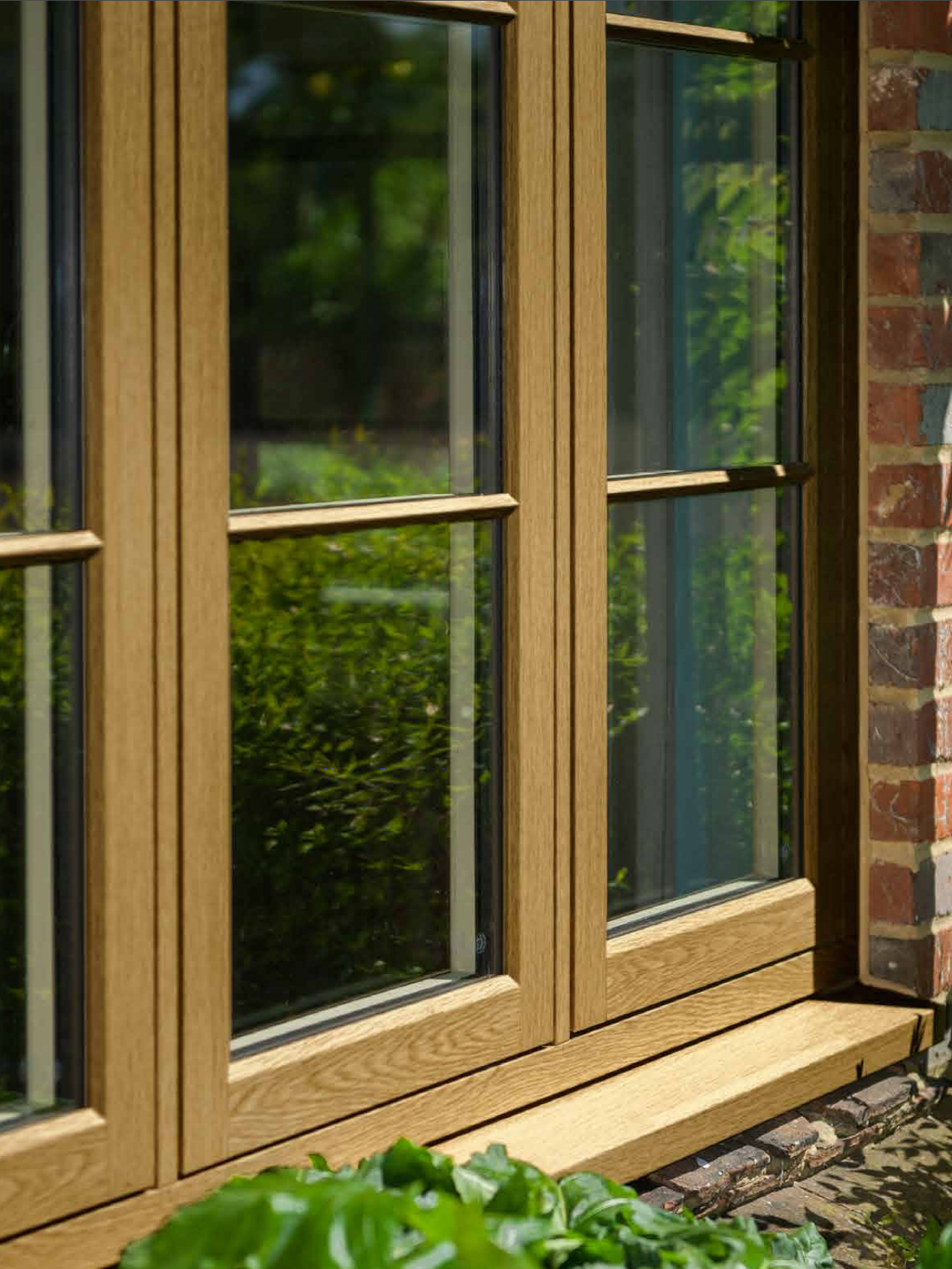 Flush Sash Timber Alternatives - Our Flush Sash 70 range of timber alternatives combines the traditional charm of timber windows with high specification UPVC units to create a striking window design that is secure and highly energy efficient.Our UPVC Flush Sash units replicate the traditional design of timber windows by using wood grain finishes and mechanical joints which replicate mortise and tenon construction.SecurityFlush Sash windows come with high performance security systems which outperform that of traditional timber models. A shoot-bolt security mechanism and a night latch come as standard meaning you can rest assured that your home is secure.Energy EfficiencyThe Flush Sash range delivers fantastic thermal performance by using 24mm double glazed units.