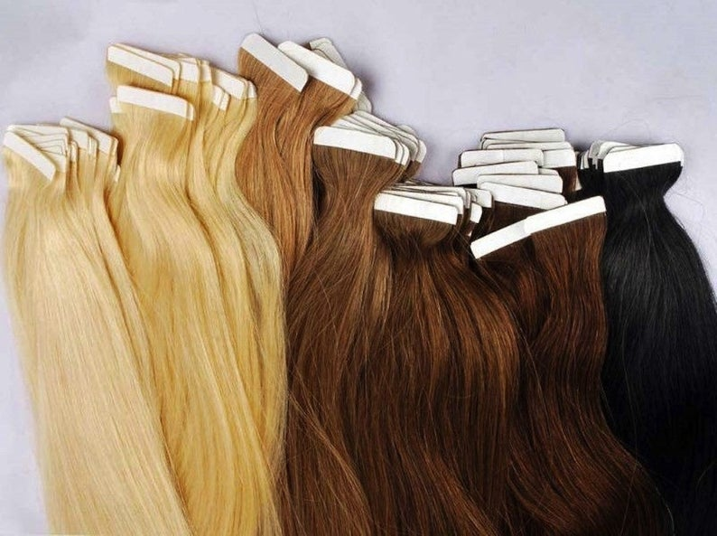 TAPE:  These individual strands have strips of clear, double-sided tape placed at the base of the weft of the hair, so you can tape them to your scalp