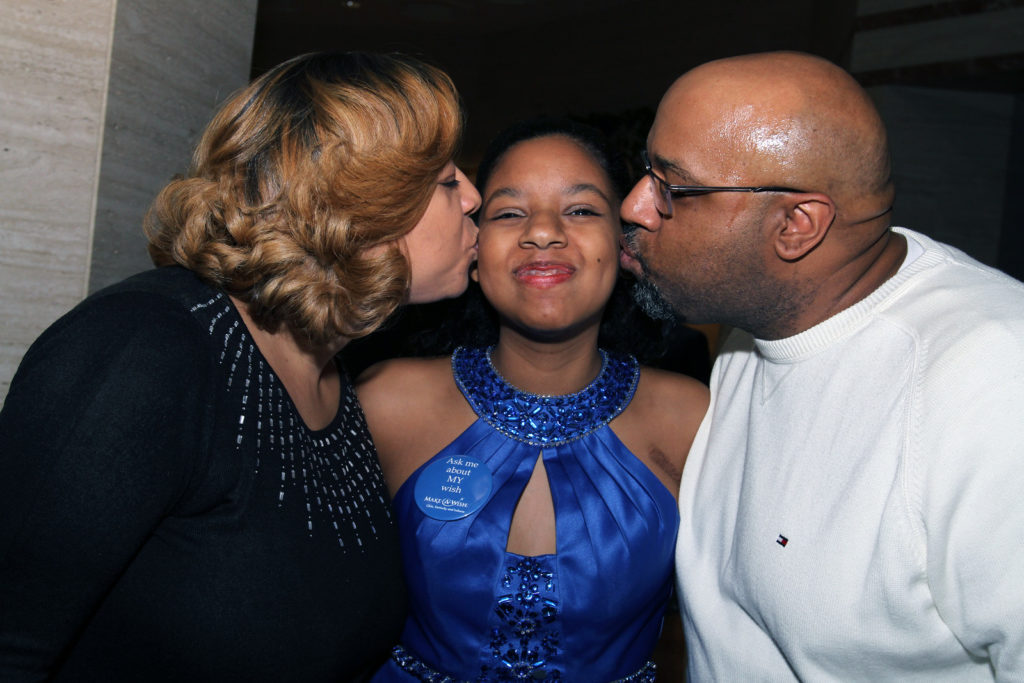 Photo – Christine's Christmas Concert. Make-a-Wish kid and her parents.