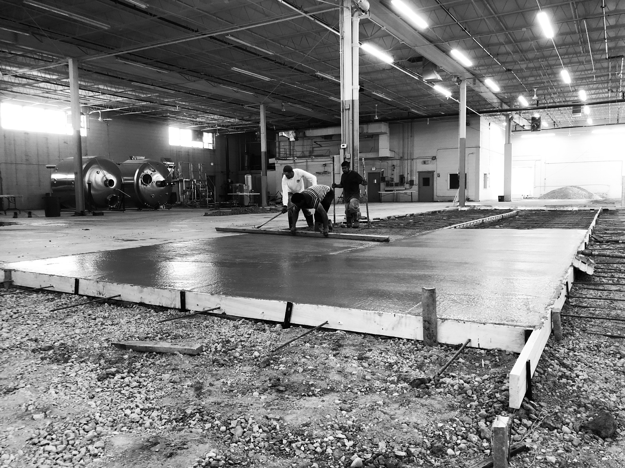 Creating the flooring for the beer production area.
