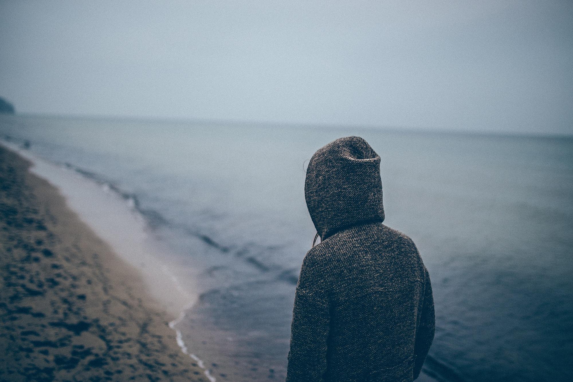 man-walking-down-beach.jpg