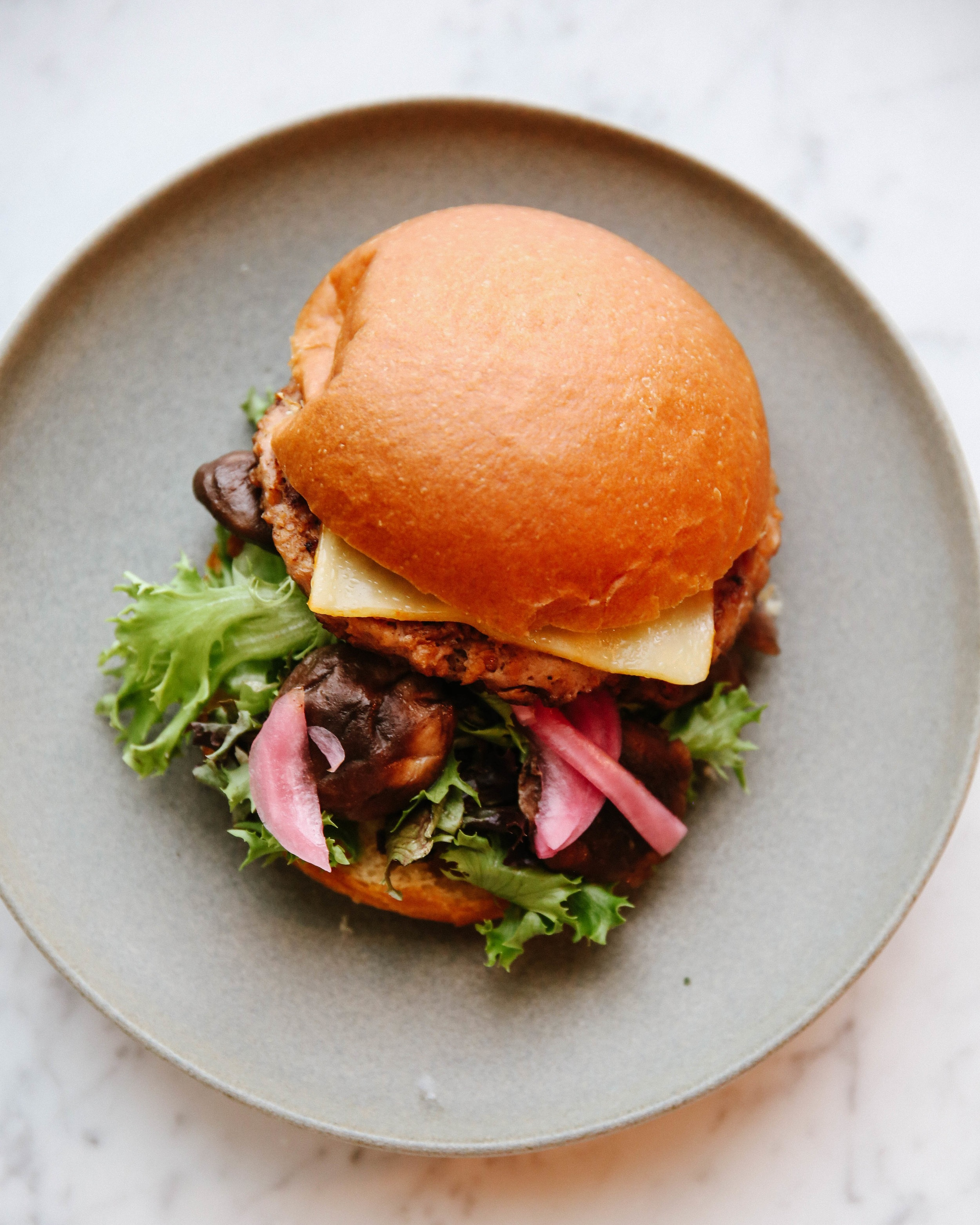 Beyond Burger - Our veggie burger is totally vegan and totally good - a Beyond Burger patty, greens, caramelized carrots, pickle, roast tomatoes and special sauce on a sprout bun. You can even swap out any bun with a GF bun or a lettuce cup, if that's what you're into.