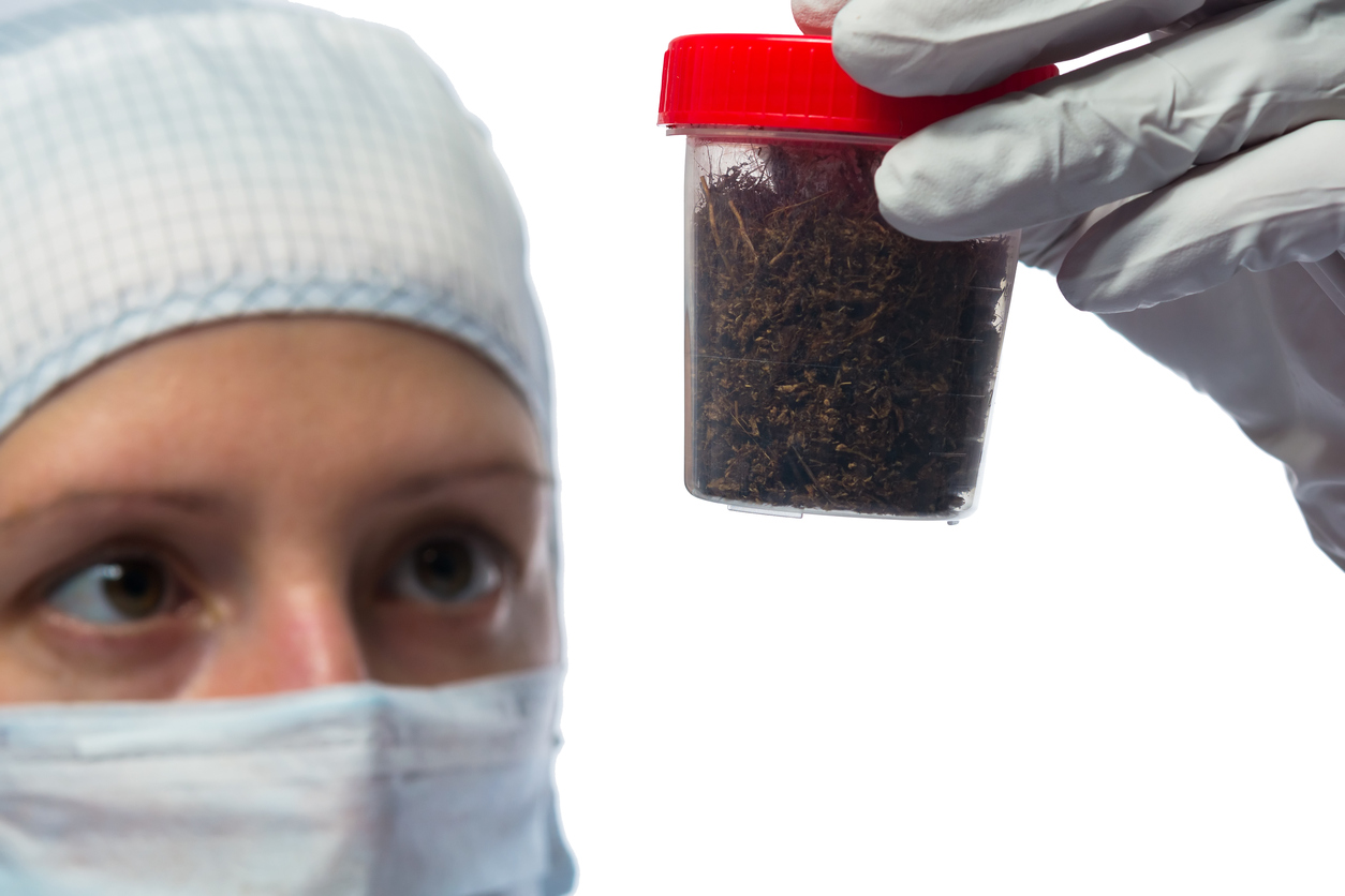 Scientist-in-protective-suit-examines-soil-622210752_1258x839.jpeg