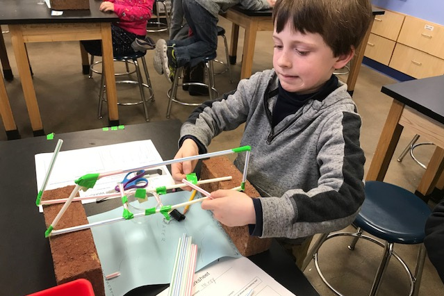 2nd/3rd Grade Bridge Project - As part of their Forces and Motion Unit, 2nd and 3rd Grade Students from Prosper Valley School spend several weeks designing and constructing bridges out of straws, with the goal of being able to support the most weight. Three teams tied for first place, supporting 1140 grams. Well done!