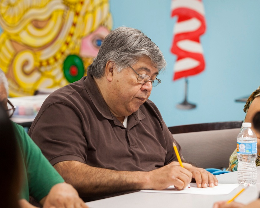 Photo caption: Wise Elders' participant drawing in an art workshop.