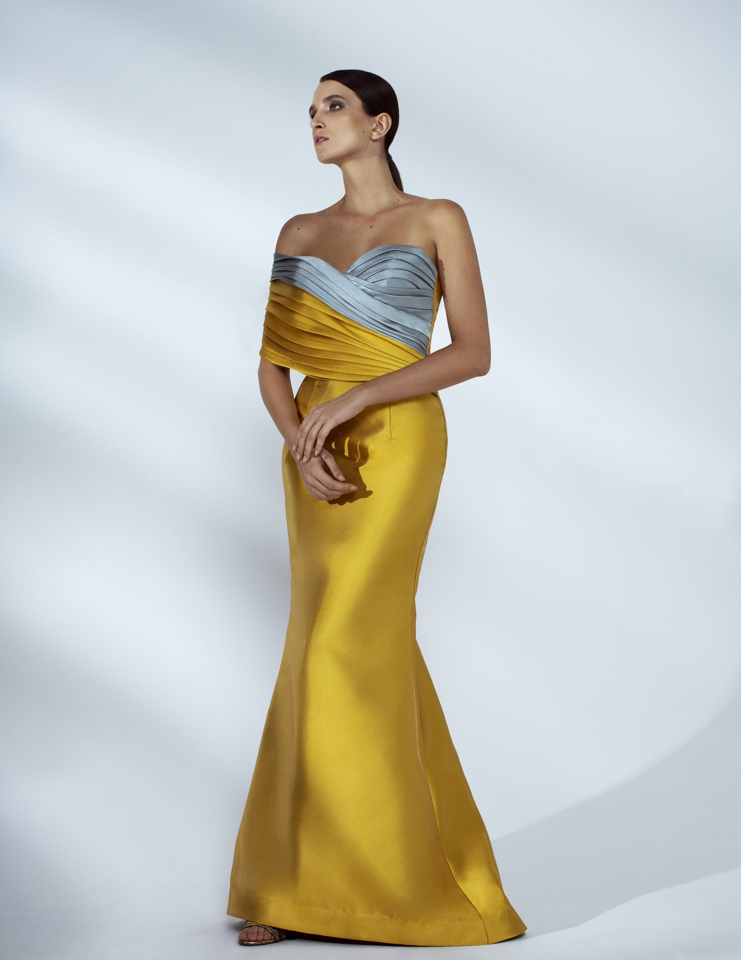 Style # - SS20015   Iman  color-block draped maxi dress