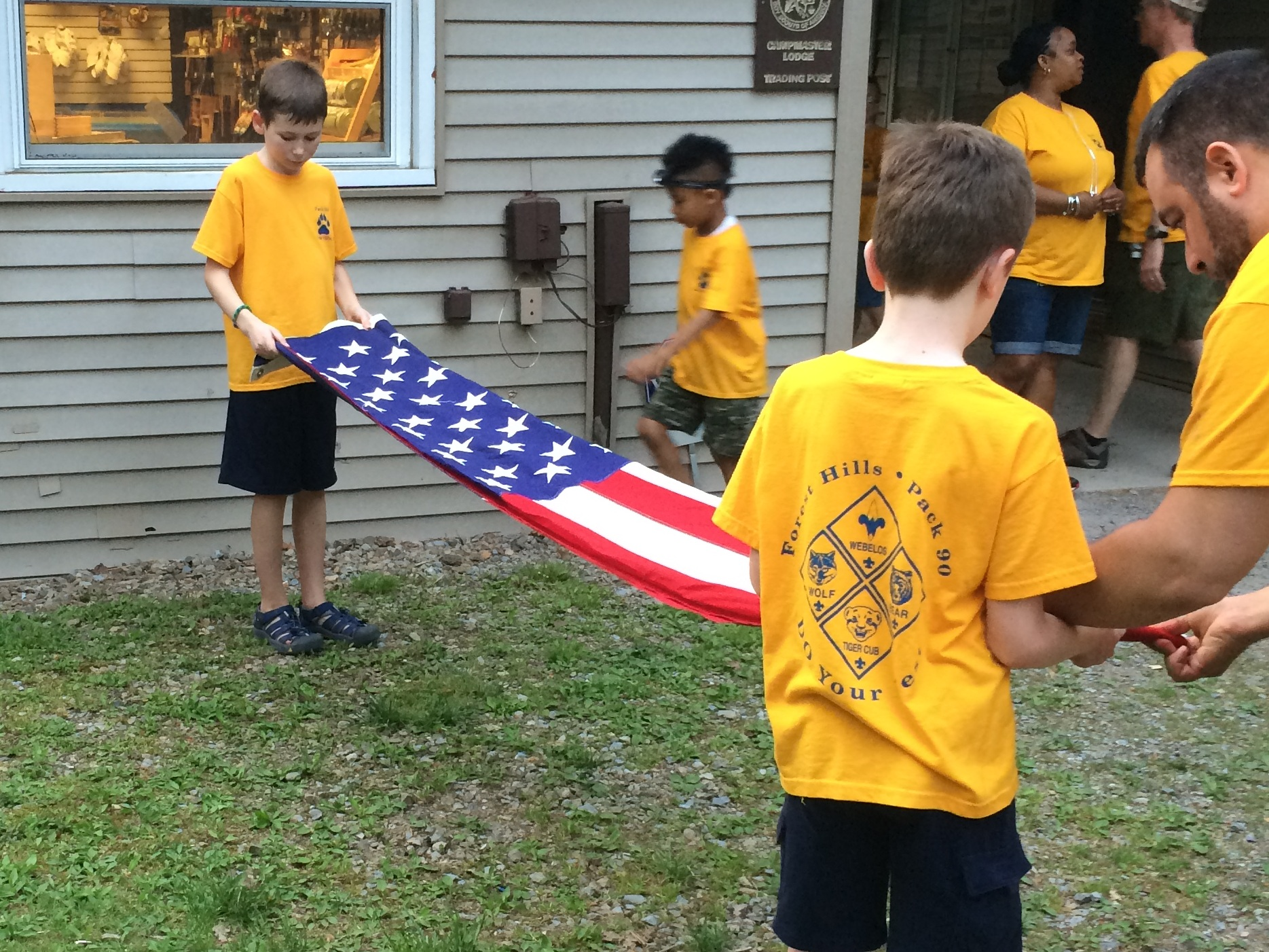 Pack 90 Webelos show reverence during a flag ceremony at Summer Camp.