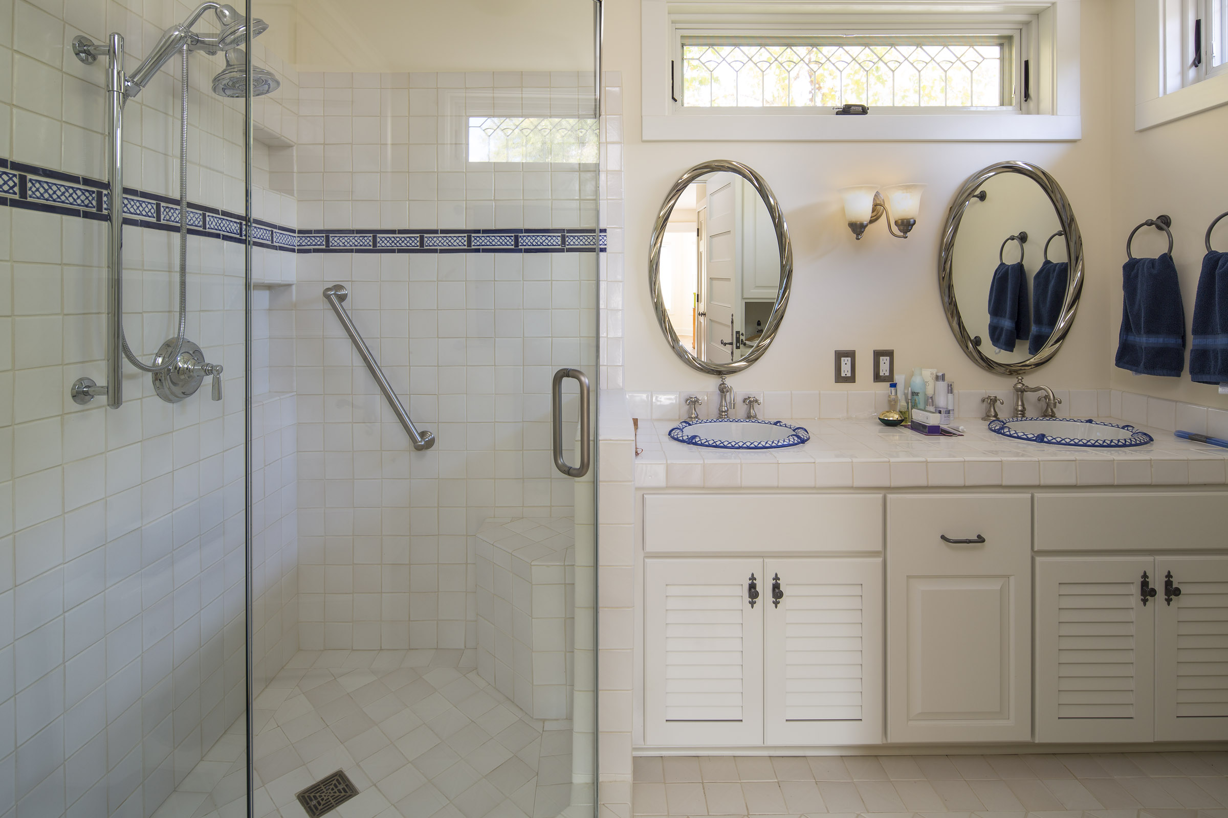 Bathroom remodeled with blue accents.
