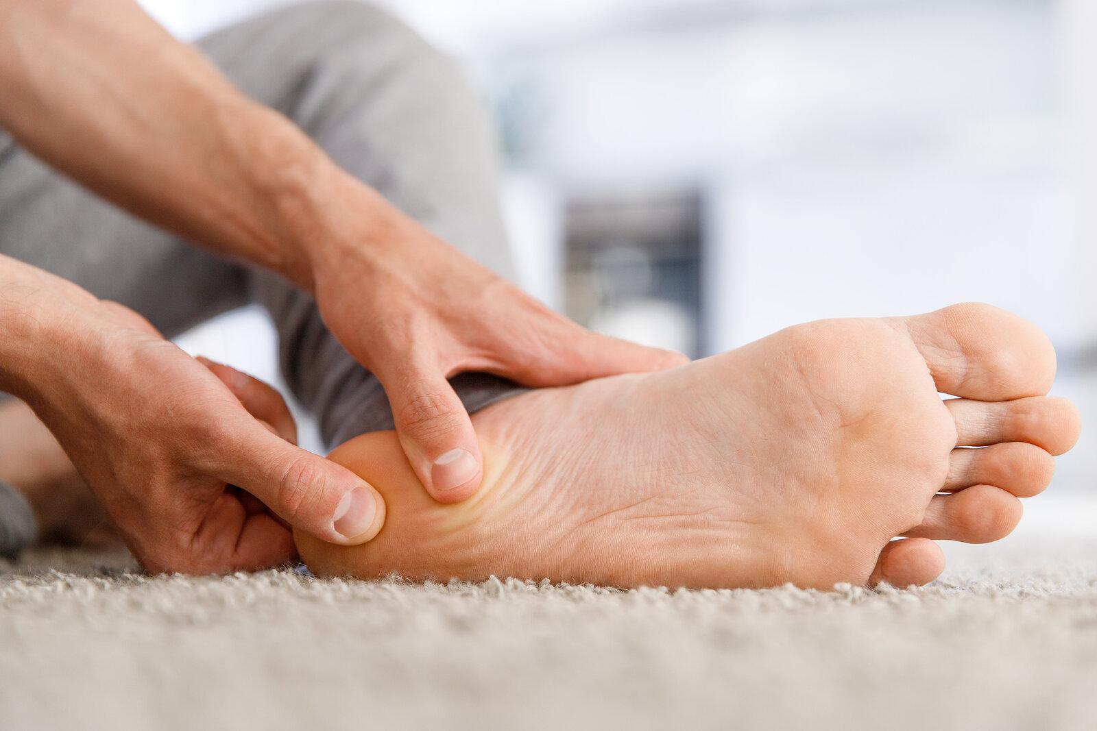 bigstock-Man-Hands-Giving-Foot-Massage--307094440.jpg