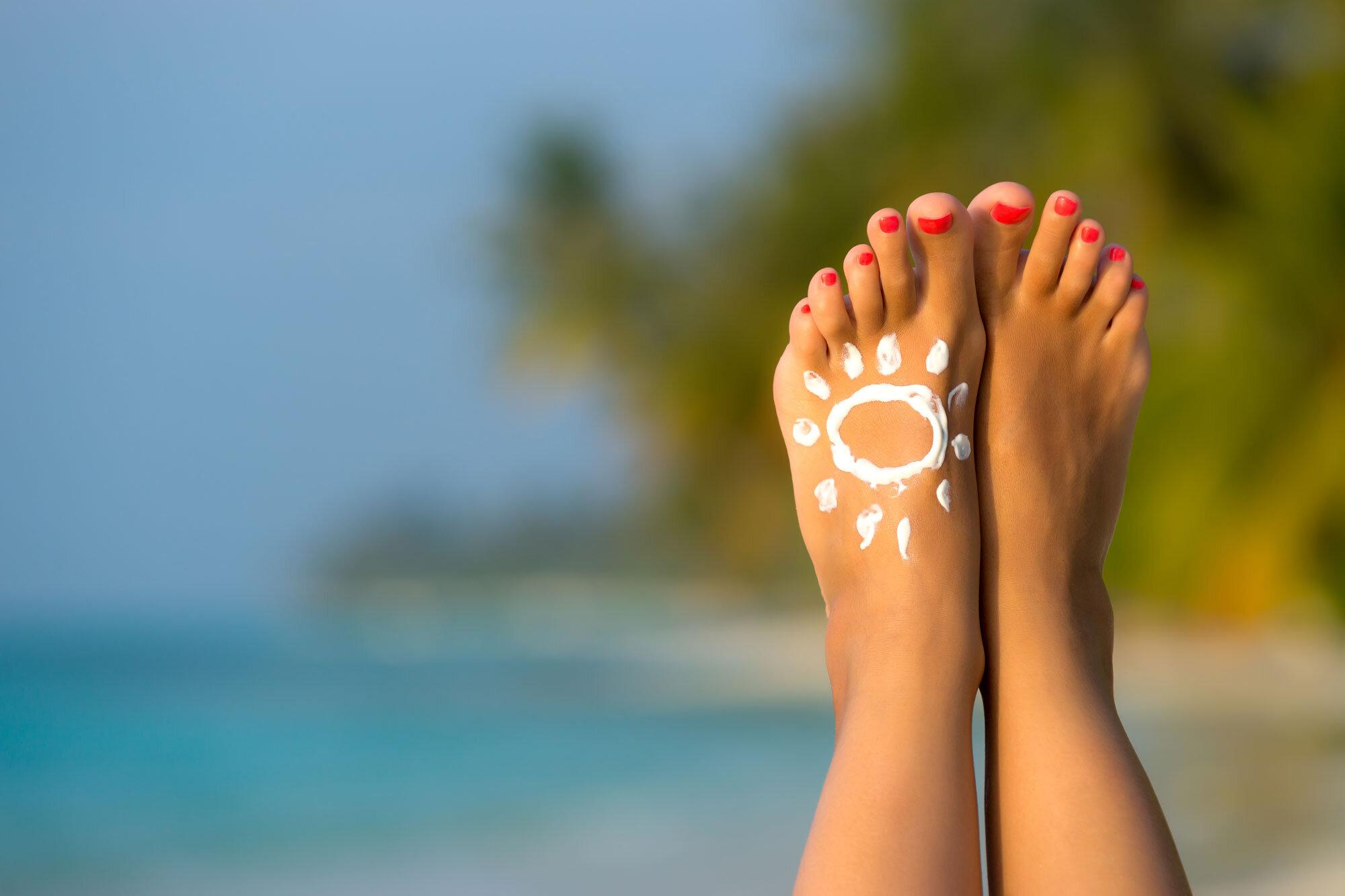 bigstock-Woman-s-Foot-With-Sun-shaped-S-83644250web.jpg