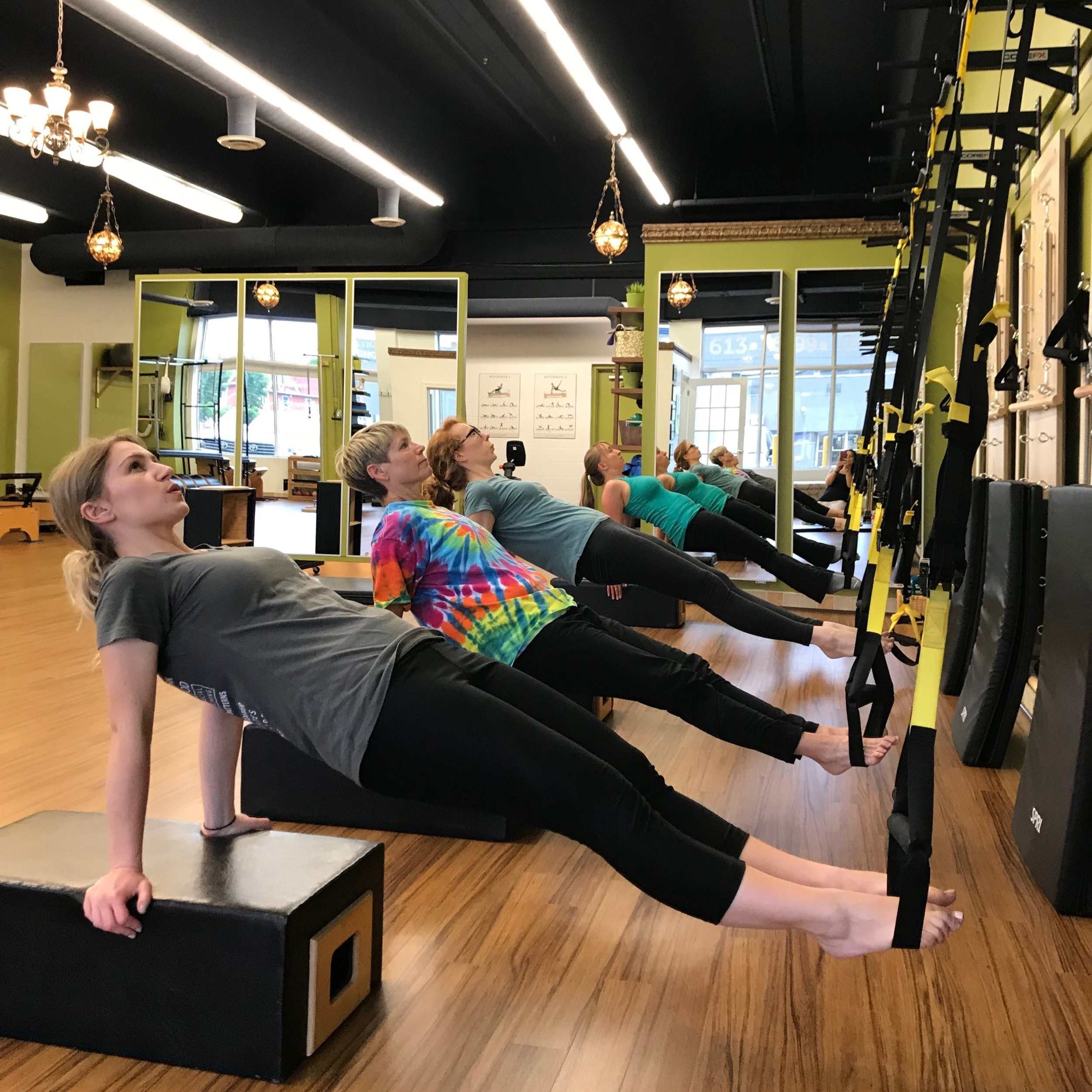 - PILATES ON THE TRXThis class adds challenge and thrill to your regular Pilates workout. Doing Pilates using the TRX suspension system helps develop strength, balance, flexibility and core stability by using gravity and body weight to build resistance. Open to all levels.