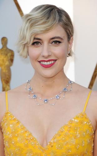 Greta Gerwig - Greta's softly highlighted asymmetric crop has been styled in wide finger waves- the epitome of classic Hollywood, but with a modern twist. The cropped style keeps it sleek and removes any bulk. Just gorgeous.
