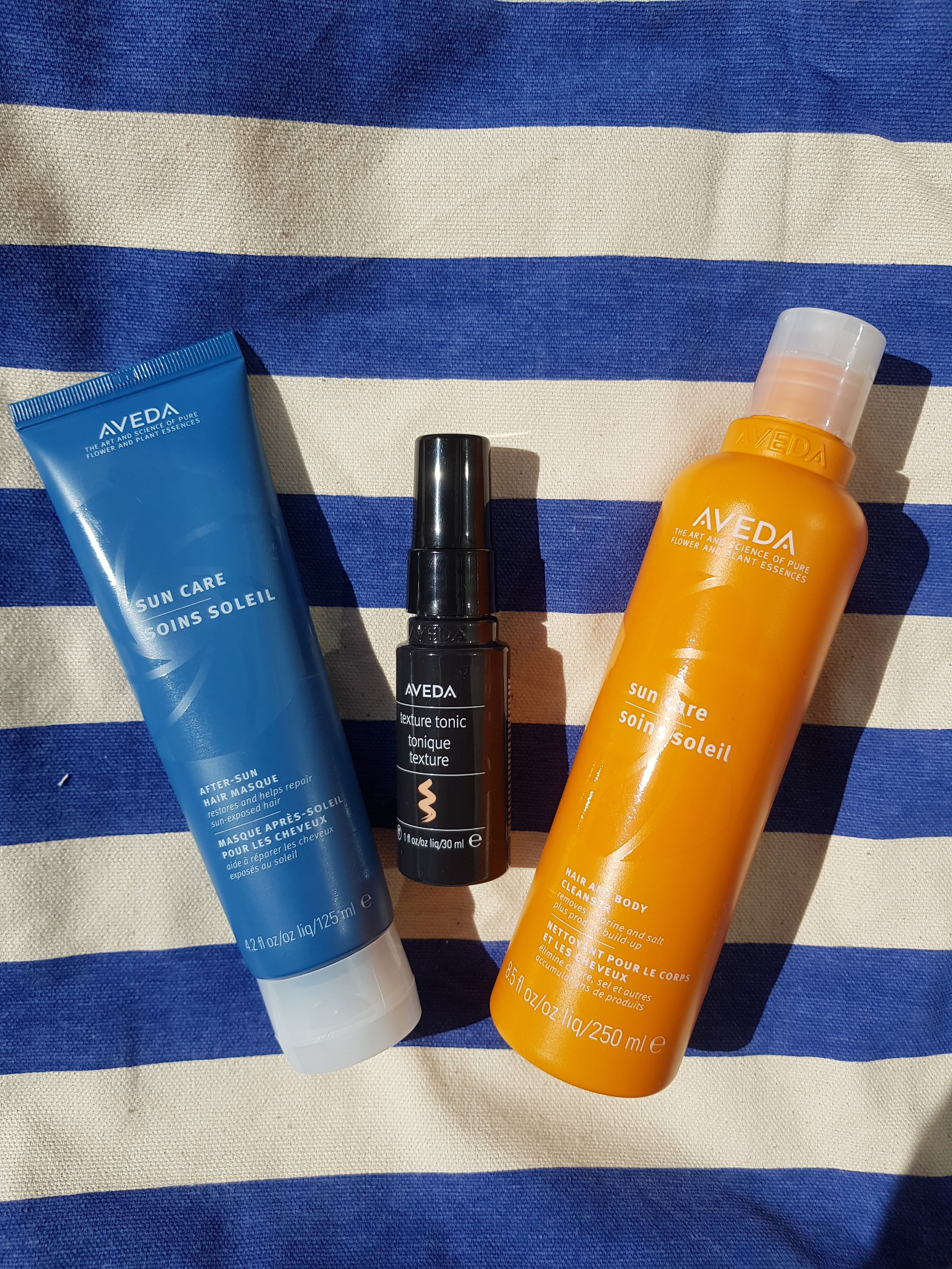 SPECIAL OFFER! - Stock up for your holidays and buy Sun Care Hair and Body Cleanser and Sun Care After-Sun Hair Masque in the salon (£43.50 for the set) and for a limited time you'll also receive a very chic striped beach tote and a travel-sized Texture Tonic, free!
