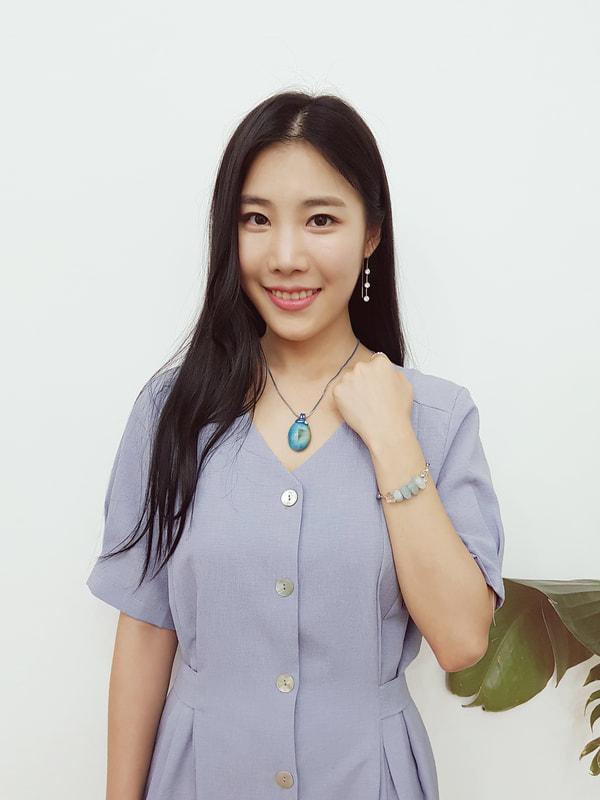Druzy Necklace and Aquamarine Bracelet belong to Nayul