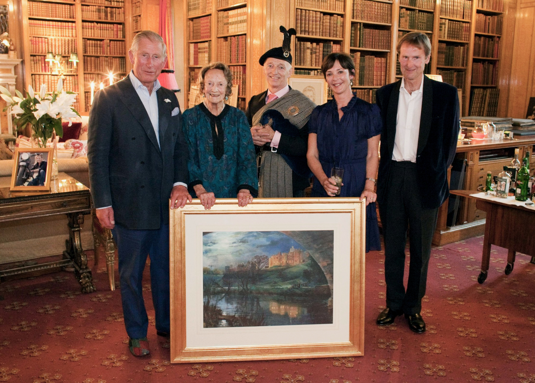 Prince Charles presenting on behalf of the Duke of Northumberland a painting of Alnwick Castle to Richard Butler to mark Richard's 30 Years as Piper to the Dukes of Northumberland    (left to right - HRH Prince Charles, Duchess Elizabeth of Northumberland, Richard Butler, Duchess Jane of Northumberland, the Duke of Northumberland )
