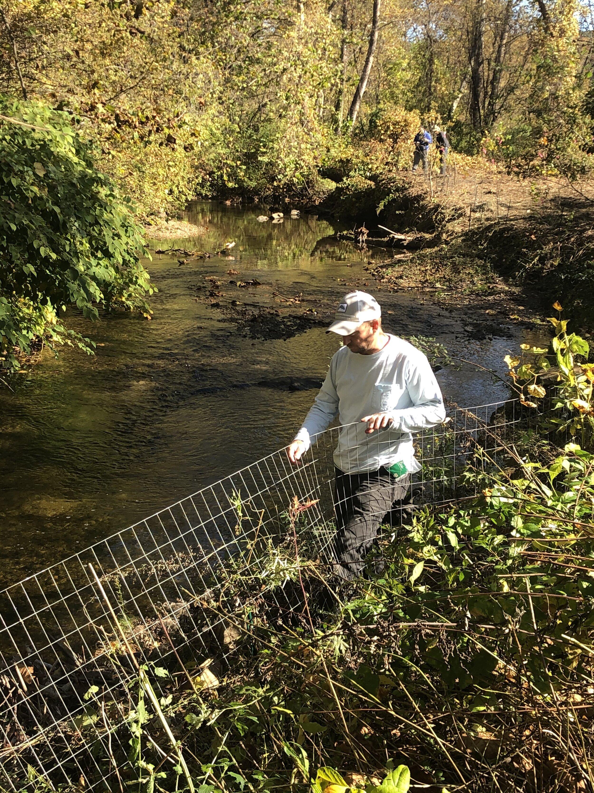 John Hildenbrand working the fence line