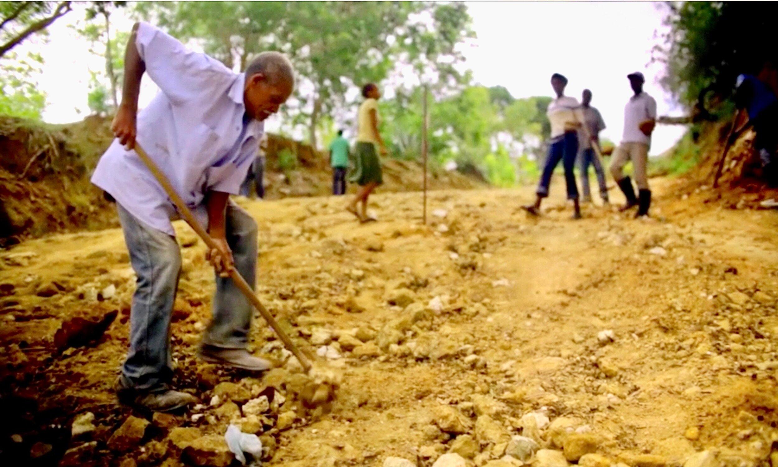 Occine 'Cine' Chery working on the Fondwa road.jpeg