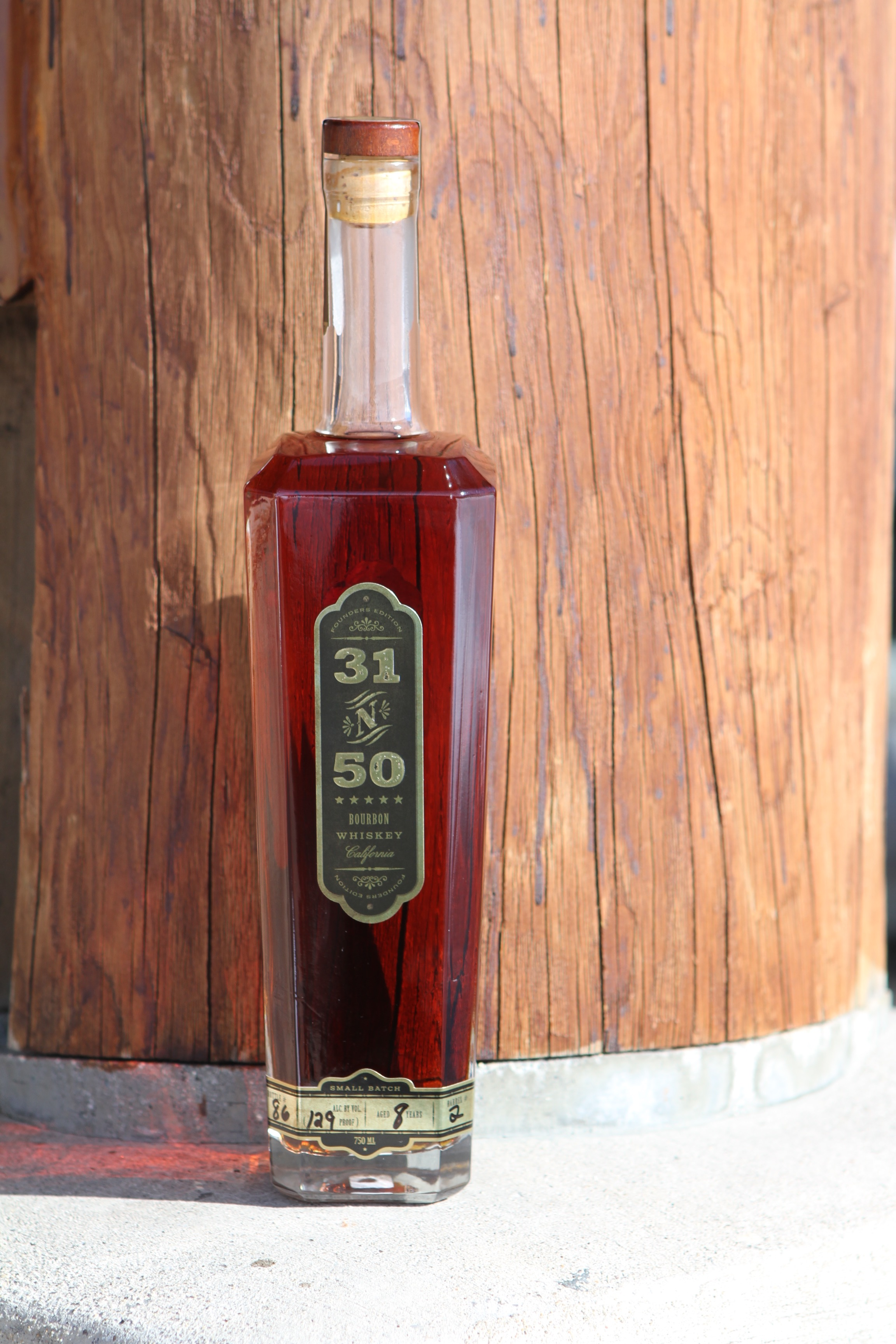 31n50 Bourbon - This is our original aging project. We wanted to prove the aging process of our warehouse and learn what happens over 10+ years. Barrel 1 started at 121 proof and 7 years of rested aging. Each successive barrel has yielded higher proof and less bottles per barrel.31n50 shows the impact of both high and low temperature cycles and a distinct lack of humidity over most of the year. The daily swings in temperature also contribute greatly to how deep the whiskey penetrates the wood.Now each barrel is over 10.5 years old and is being bottled at different barrel proof (s). The final 8 barrels of the 12 originals are being bottled now (barrels 1 - 4 are sold out). They will be sold in succession.Current Barrel: No.5142.6 PF